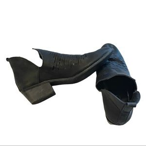 Yoki black booties with side slits and laser cuts